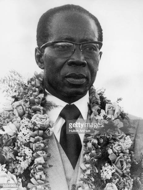First president of Senegal Leopold Sedar Senghor wearing a garland of flowers, 1976. A poet and writer as well as a politician, Senghor helped create...