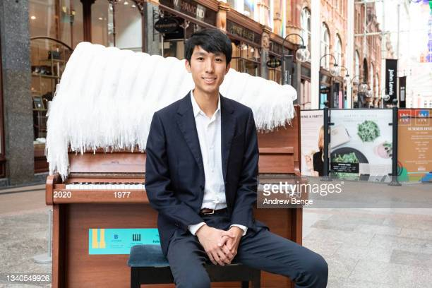 First Prize and gold medalist at the Leeds International Piano Competition in 2018 Eric Lu poses in Victoria Quarter during the Leeds Piano Trail...