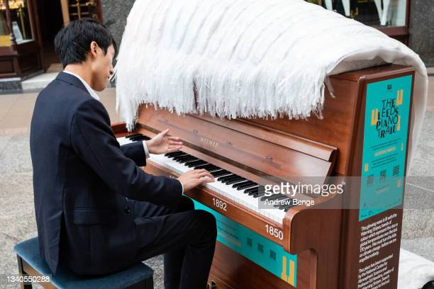 First Prize and gold medalist at the Leeds International Piano Competition in 2018 Eric Lu performs in Victoria Quarter during the Leeds Piano Trail...