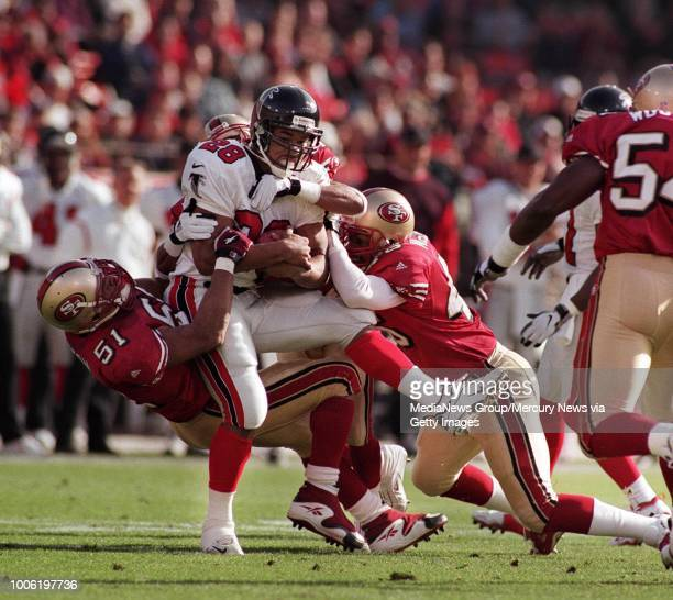 First quarter forty Niners defense at left #51 Ken Norton Jr does his part to bring down Falcon Ken Oxendine