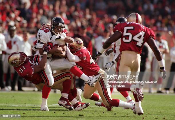 First quarter Fourty Niners defense First quarter forty Niners DefenseAt left #51 Ken Norton Jr does his part to bring down Falcon Ken Oxendine