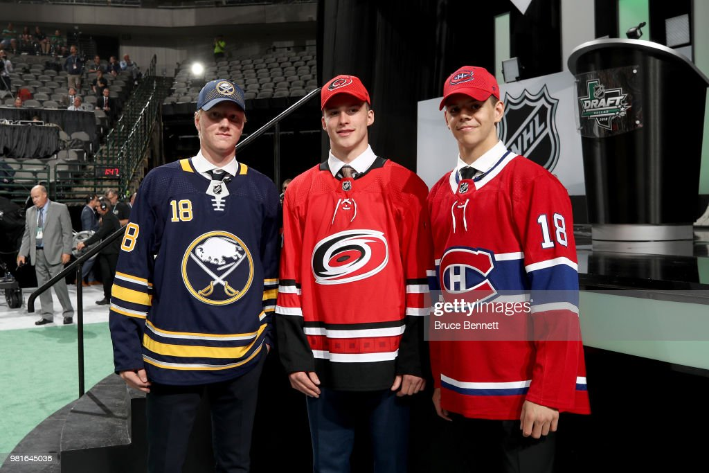 First Rasmus Dahlin of the Buffalo Sabres, second Andrei Svechnikov of the Carolina Hurricanes and third Jesperi Kotkaniemi of the Montreal Canadiens pose during the first round of the 2018 NHL Draft at American Airlines Center on June 22, 2018 in Dallas, Texas.