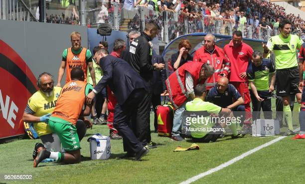 First referee assistant Giulio Dosobz and Khouma Babacar of Sassuolo get injured during the serie A match between FC Crotone and US Sassuolo at...