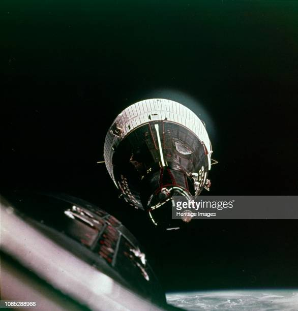 First rendezvous in space, 15 December 1965. The Gemini 7 spacecraft as seen from the Gemini 6 spacecraft - during the meeting they were only a foot...