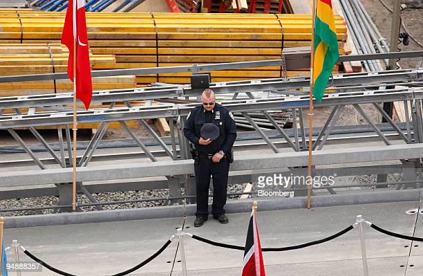 A first responder observes a moment of silence during a ceremony at Ground Zero the 16acre World Trade Center site in New York US on Thursday Sept 11...