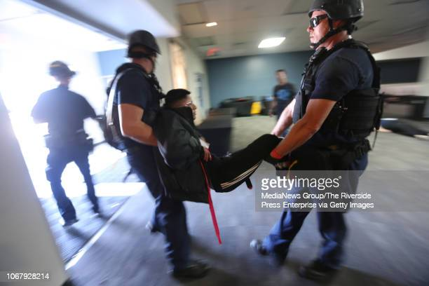 First responders carry out a victim as part of an active shooter training exercise at Bourns in Riverside on Wednesday November 14 2018 About 150...