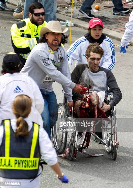 CONTENT** First responders including Carlos Arredondo in cowboy hat tend to Jeff Bauman who was severely wounded after two explosions occurred along...