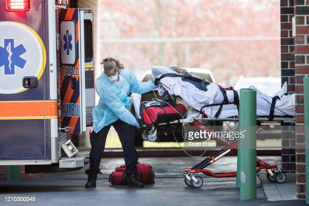 First responders load a patient into an ambulance from a nursing home where multiple people have contracted COID-19 on April 17, 2020 in Chelsea,...