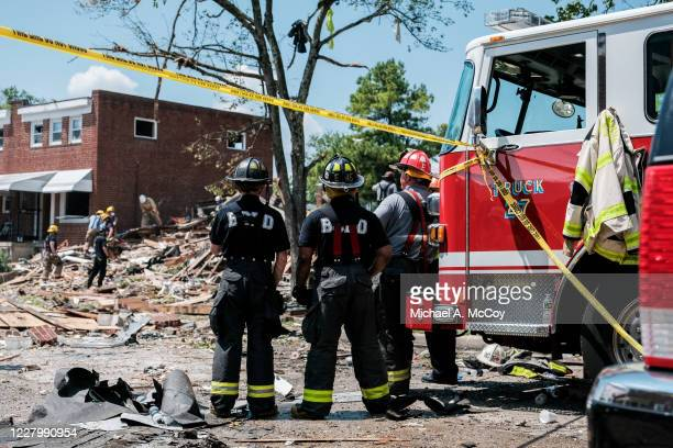 First responders search for survivors at the scene of an explosion on August 10, 2020 in Baltimore, Maryland. Early reports indicate that a gas leak...