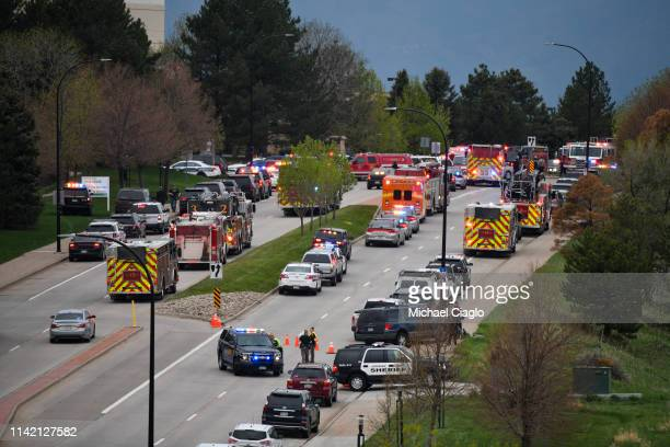First responders stage on a road outside STEM School Highlands Ranch where at least seven students were injured during a shooting on May 7 2019 in...