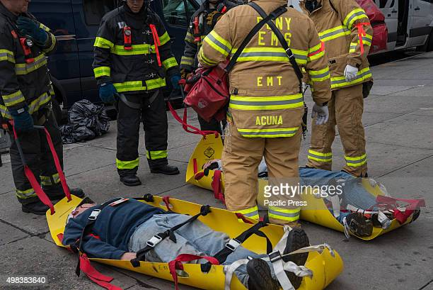 FDNY first responders stand next to simulated victims that they have helped to remove from the danger area via portable body sleds NYC first...