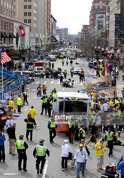 First responders tend to the wounded where two explosions occurred along the final stretch of the Boston Marathon on Boylston Street in Boston...