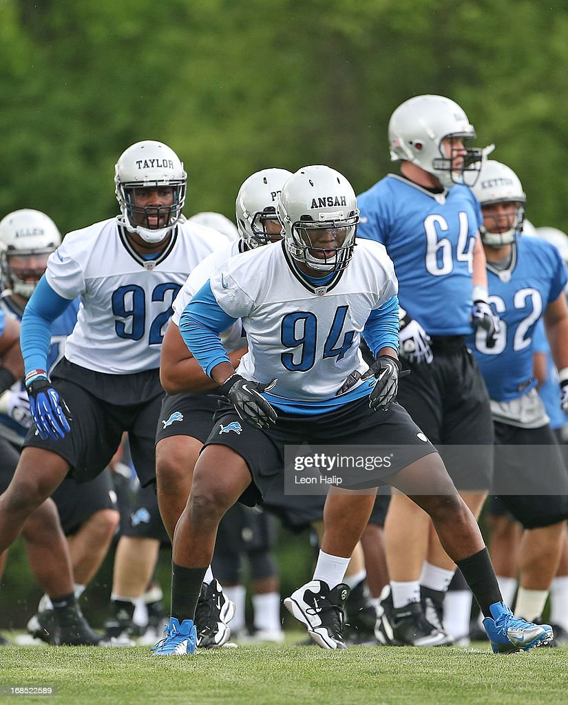 First round draft pick Ezekiel Ansah #94 of the Detroit Lions joint his teammates in the warmups prior to the start of the afternoon drills during the first day of Rookie Camp on May 10, 2013 in Allen Park, Michigan.