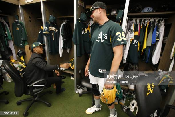 First round draft pick Kyler Murray of the Oakland Athletics talks with Blake Treinen in the clubhouse after singing his contact at the Oakland...