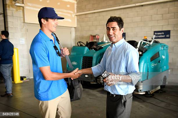 First round number one draft pick Cal Quantrill of the San Diego Padres visits with AJ Preller prior to the game against the Miami Marlins at PETCO...