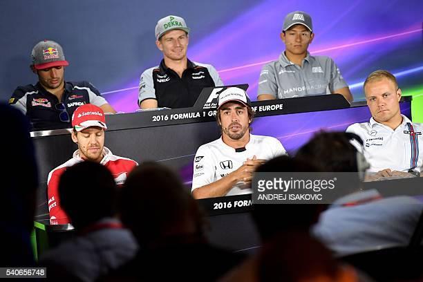 Scuderia Ferrari's German driver Sebastian Vettel McLaren Honda F1 Team's Spanish driver Fernando Alonso Williams Martini Racing's Finnish driver...