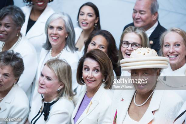First row from left Reps Jan Schakowsky DIll Sylvia Garcia DTexas Speaker Nancy Pelosi DCalif and Alma Adams DNC pose for a group photo of House...