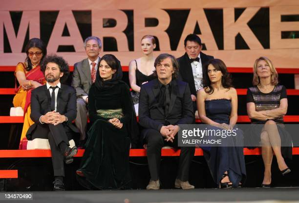 First row members of the Jury Romanian director Radu Milaileanu Iranian actress Leila Hatami President of the jury Serbian director Emir Kusturica...
