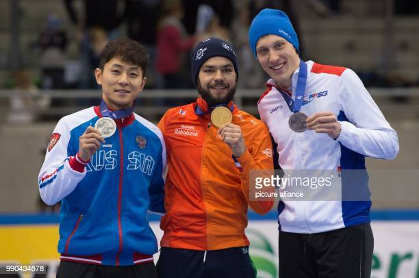 First runnerup Victor An from Russia winner Sjinkie Knegt from the Netherlands and second runnerup Sebastian Lepape from France show their medals at...