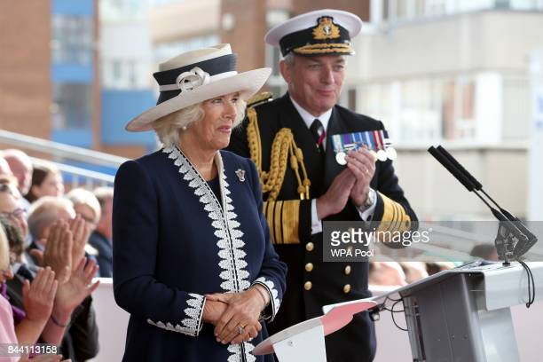 First Sea Lord Admiral Sir Philip Jones applauds Camilla Duchess of Rothesay during a naming ceremony of aircraft carrier HMS Prince of Wales at the...
