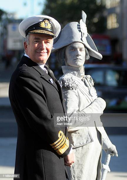 First Sea Lord and Chief of the Naval Staff Admiral Sir Alan West pictured next to actor Oliver Broad dressed as Nelson in Trafalgar Square London as...