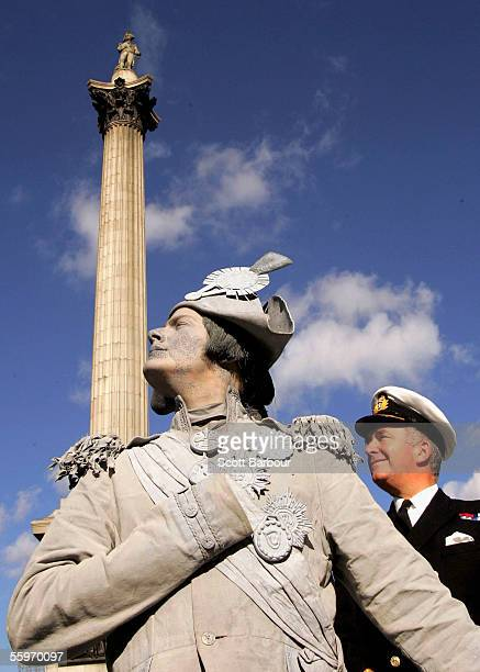 First Sea Lord and Chief of the Naval Staff Admiral Sir Alan West poses with the 'Living Statue' of Lord Nelson during a photocall in Trafalgar...