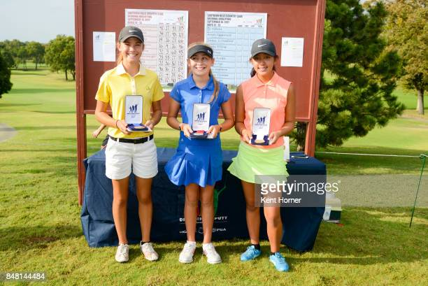 First second and third place putting skills for girls age 1213 category Nicole Kolbas Ali Mulhall and Kaylee Chen pose with their medals during a...