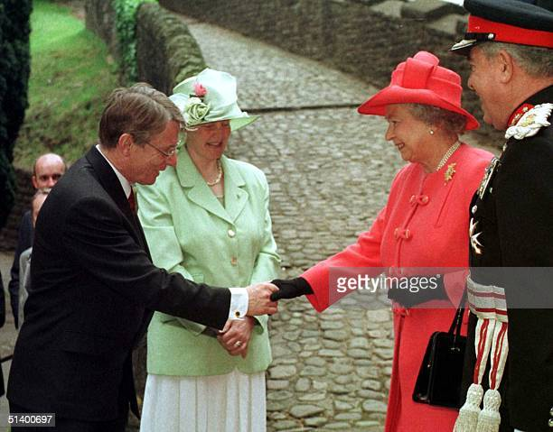 First Secretary of the Assembly, Alun Michael , accompanied by his wife Mary greets The Queen and the Lord Lieutenant of South Glamorgan Norman Lloyd...