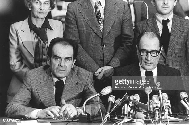 First Secretary of the French Communist Party Georges Marchais with First Secretary of the Socialist Party François Mitterrand sign the 'Union de la...