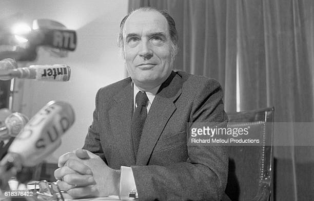 First Secretary of the French Socialist Party Francois Mitterrand sits with his hands folded in Paris