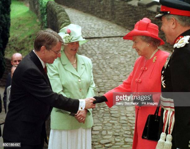First Secretary of the Welsh Assembly, Alun Michael, accompinied by his wife Mary, greets the Queen and the Lord Lieutentant of South Glamorgan...