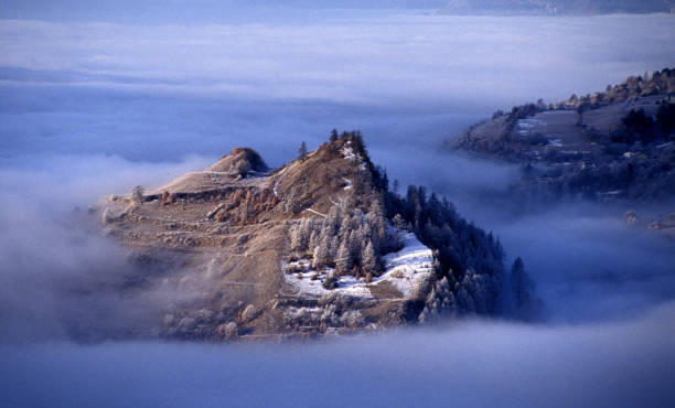 First snow on a hill in fog