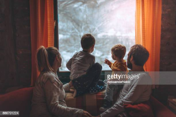 first snow - looking through window stock pictures, royalty-free photos & images