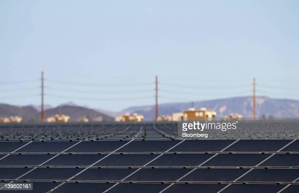First Solar Inc photovoltaic solar panels reflect light at the Agua Caliente Solar Project in Yuma County Arizona US on Wednesday Feb 16 2012 Arizona...