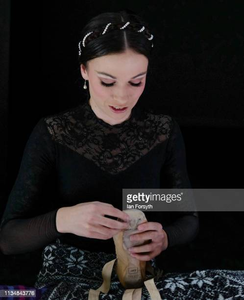 First Soloist Abigail Prudames makes final adjustments to her ballet shoes minutes before the curtain goes up for the World Premier of Northern...