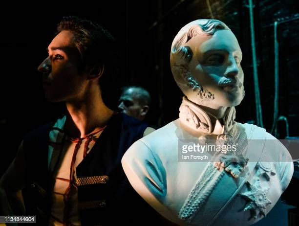 First Soloist Joseph Taylor dancing as Albert stands next to a bust of Albert as he looks on from the wings waiting to enter the stage during the...