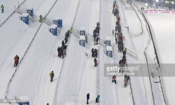 First spectators wait ahead of the trainings and qualifiers of the fourth stage of the FourHills Ski Jumping tournament in Bischofshofen Austria on...