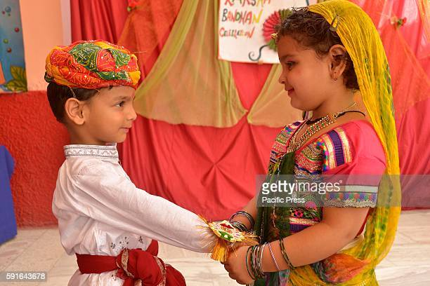 First step school children during Raksha Bandhan It's a Hindu festival where the brother promises to take care of his sisters from all evil and in...