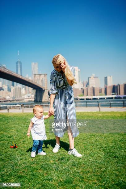 First steps for the baby girl in big city