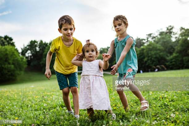 first steps of our sister - sibling stock pictures, royalty-free photos & images