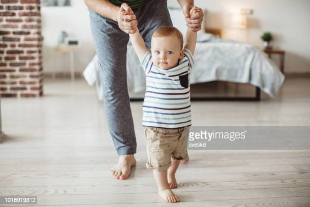 first steps - stay at home father stock pictures, royalty-free photos & images