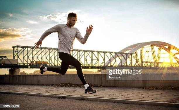 first sun jogging - sportsperson stock pictures, royalty-free photos & images