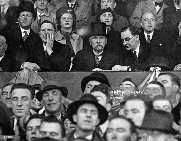 First Taoiseach of the Republic of Ireland Eamon de Valera attending his first football match in an official capacity at the international game...