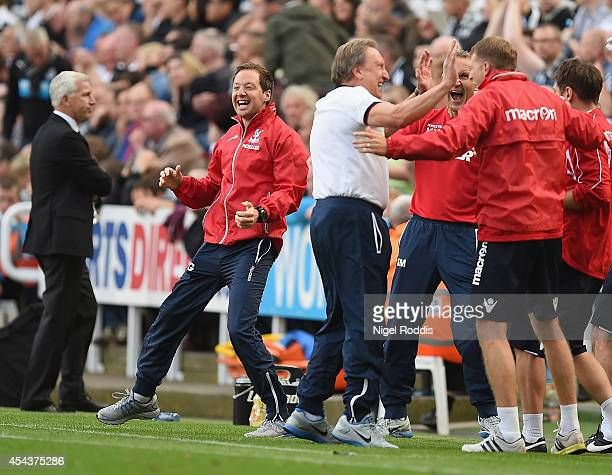 First team coach Ben Garner, Manager Neil Warnock of Crystal Palace and his coaching staff celebrate after Wilfried Zaha of Crystal Palace scored...