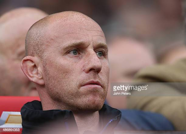 First Team Coach Nicky Butt of Manchester United watches from the dugout during the Barclays Premier League match between Manchester United and...