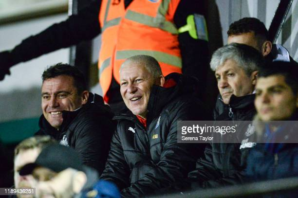 First team coach Steve Harper sits with Goalkeeping Coach Simon Smith and Academy Manager Joe Joyce during the Premier League International Cup match...