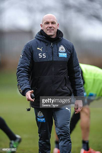 First Team Coach Steve Stone walks on the pitch during a Newcastle United Training session at The Newcastle United Training Centre on March 13 in...