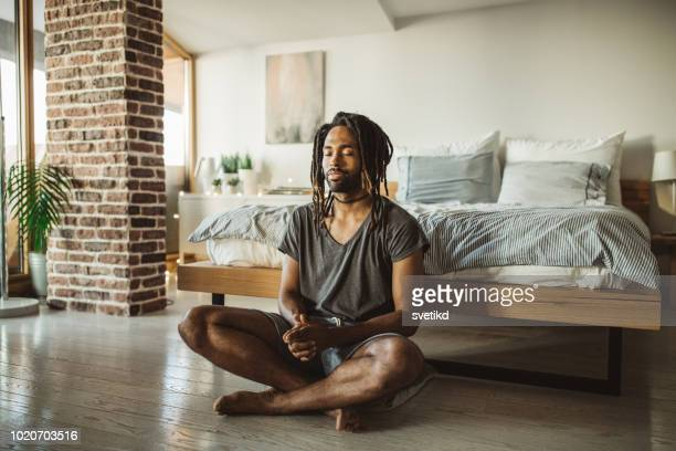 first thing in the morning for him is yoga - mindfulness stock pictures, royalty-free photos & images