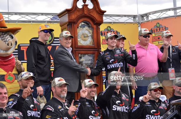 First time Camping World Truck winner Noah Gragson Switch Toyota celebrates in Victory Lane with racing team and owner Kyle Busch after winning the...