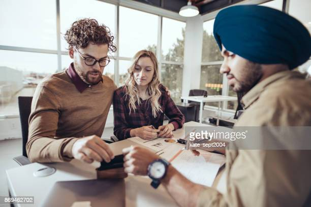 first time home buyers and real estate agent - sikh stock pictures, royalty-free photos & images